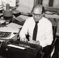 Robert Liebman typing on a typewriter
